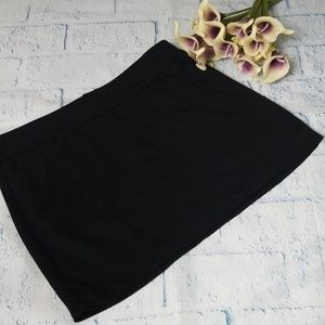 WHBM solid black mini skirt with pockets